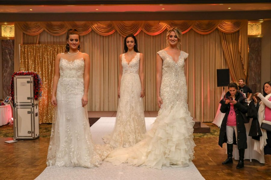 3 models on runway for bridal fashion show