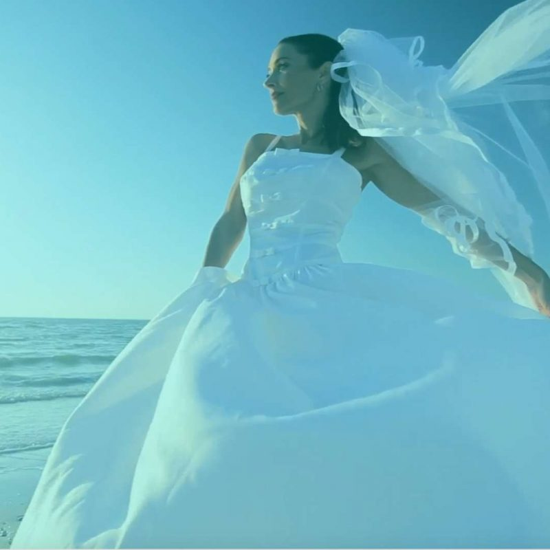 Bride on the beach New England Bridal Affair