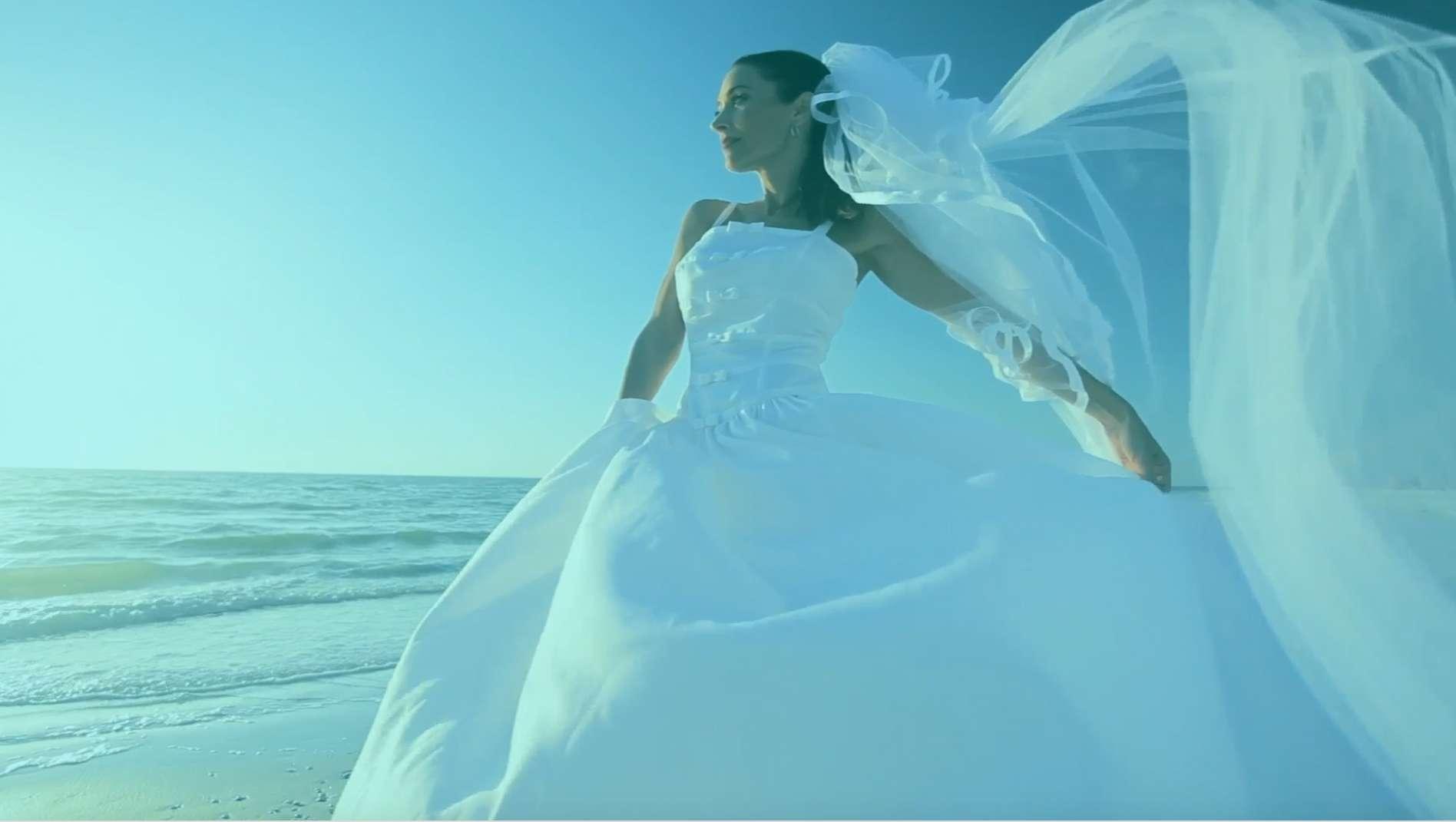 Bride on the beach New England Bridal Affair