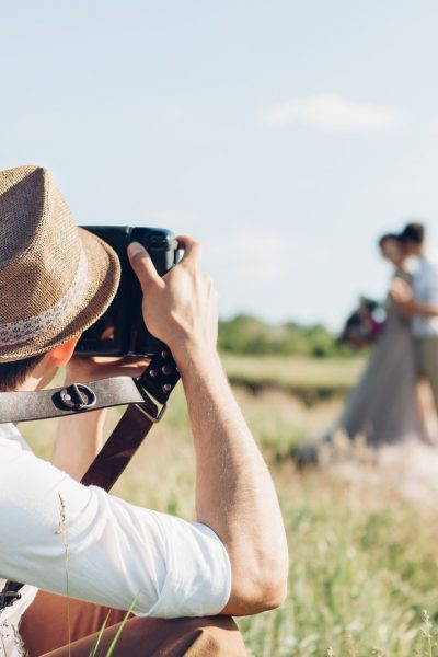 wedding photographer in a field
