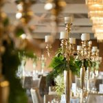 For the centerpieces, we wanted that touch of vintage, choosing golden candelabras with cascading florals down the stems.