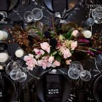 Peonies with black on black wedding reception